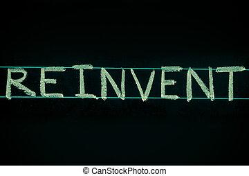 reinvent word handwritten on black chalkboard - reinvent...