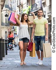 reisende, einkaufstüten