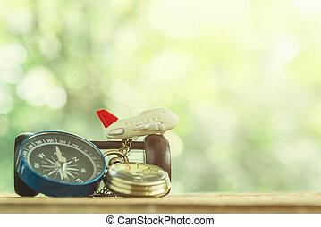 reizen, achtergrond, concept., klein vliegtuig, met, gouden horloge, en, kompas, op, hout, tafel, met, doorlopene boom, en, zonlicht, achtergrond., afbeelding, voor, optellen, tekst, message., achtergrond, voor, ontwerp, kunst, work.