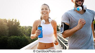 reizend, athletische, paar, junger, zusammen, jogging, draußen