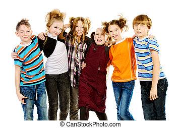 rejoice - Group of cheerful schoolchildren standing...