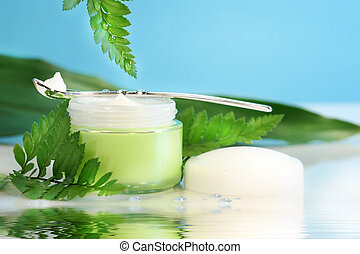 Rejuvenating face cream with ferns and water reflection