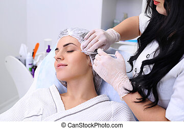 Rejuvenating facial injections. - Beautiful girl on...