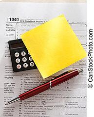 rekenmachine, aangiftebiljet, pen, sticker, rood
