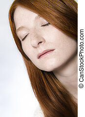 reklaxing redhead - Studio portrait of a natural redhead...