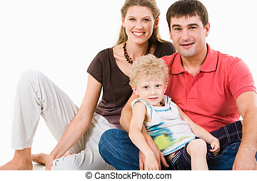 Relation - Photo of mother, father and son looking at camera...