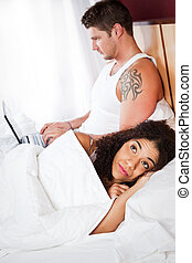 Relationship conflict - A shot of an interracial couple ...