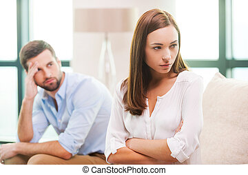 Relationship difficulties. Depressed young woman keeping...