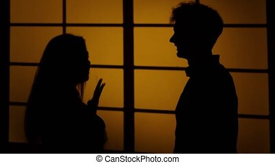 Relationship difficulties. Silhouette. Close up