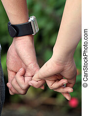Relationship - Holding hands in the garden