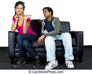 relationship problems - man and woman fighting on a couch