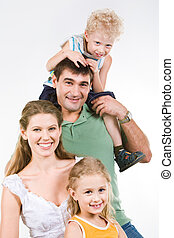 Relationship - Portrait of boy sitting on neck of father...