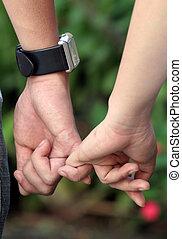 Relationship - Holding hands in the garden