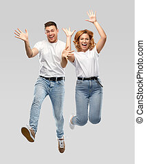 happy couple in white t-shirts jumping