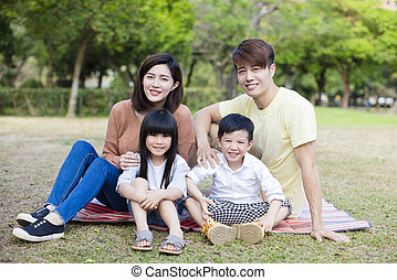 relax and happy family in the park