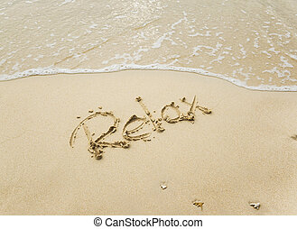 Relax is written in sand on a beach