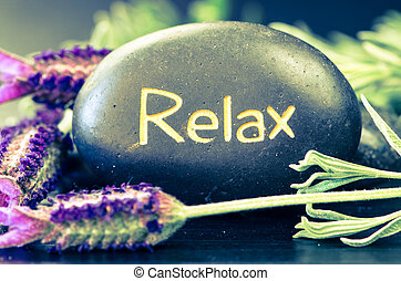 relax lava stone - black lava stone with words relax and...