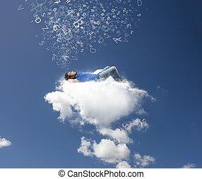 A boy relaxing on a soft cloud