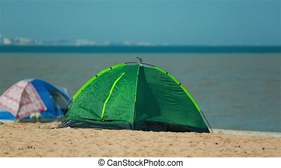 Relax on the beach in a tent with the children.
