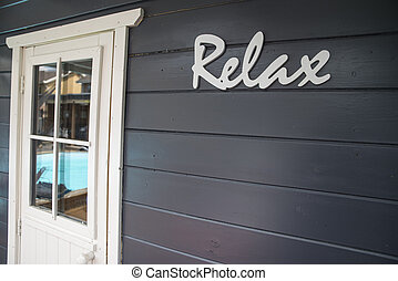 relax sign at the pool