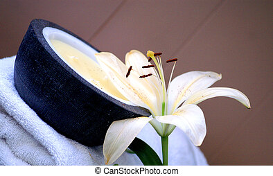 relax spa - angled image of a lilly and towel and candel to...