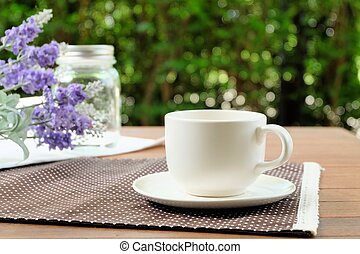Relax with a cup of coffee in the garden