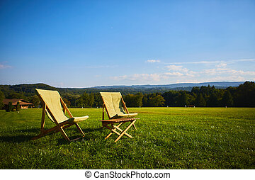 Relax with wooden chair and table. Enjoy the view of garden forest