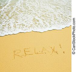 relax written in a sandy tropical beach