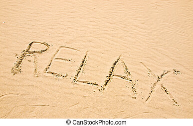 Relax Written in the Sand on a Sunny Day