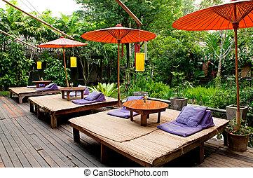 Relaxation bed near the garden - Traditional Thai umbrella...