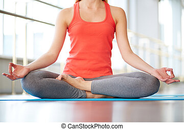 Relaxation exercise - Lower part of slim female meditating ...