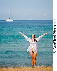 Relaxation exercise - Young woman relaxing on the beach