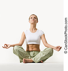 Relaxation - Image of young pretty woman sitting in pose of ...