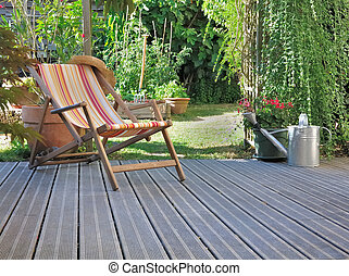 relaxation in terrace - lounge chair on wooden terrace...