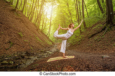 Relaxation joga pose  in wonderful  forest .