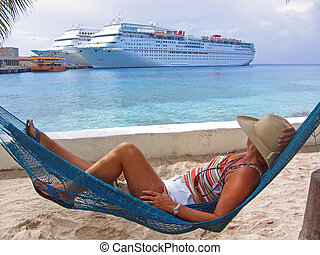 Relaxation Point - A woman rests on a hammock and views...