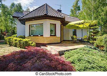 Relaxation space beside modern villa