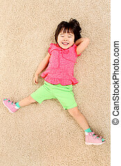 Relaxation - Portrait of adorable girl relaxing on the floor...
