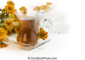 Relaxation - Cup of herbal tea and flowers on a white...
