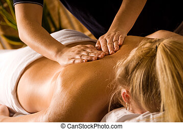 Relaxation - woman at a day spa getting a back massage