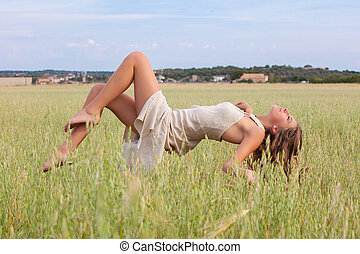 relaxation woman floating in field