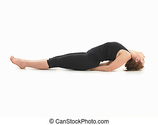 relaxation yoga posture - single young woman in lying yoga ...