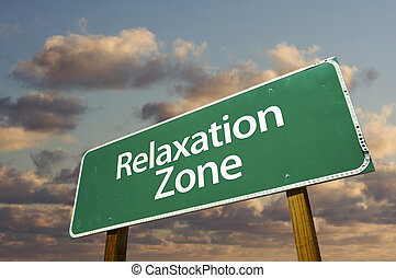 Relaxation Zone Green Road Sign In Front of Dramatic Clouds and Sky.