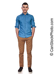 relaxe casual man standing with hands in pockets