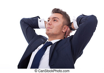 relaxed and dreaming business man over white background