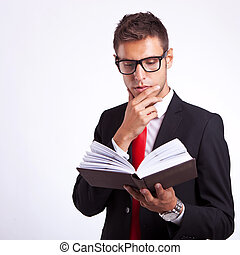 pensive business man reading a book