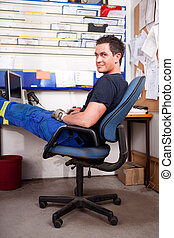 Relaxed Auto Mechanic - A relaxed auto mechanic leaning back...
