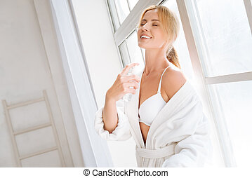 Relaxed blonde feeling happiness after shower