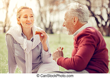 Relaxed blonde woman looking at her husband