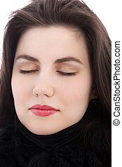 Relaxed brunette woman with eyes closed, close up